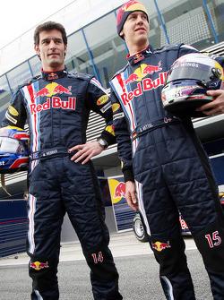 Sebastian Vettel and Mark Webber pose with the new Red Bull RB5