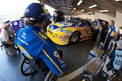 Crew chief Bootie Barker looks on as Michael Waltrip, Michael Waltrip Racing Toyota gets ready
