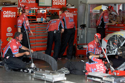 Stewart-Haas Racing Chevrolet crew members prepare the back of car of Tony Stewart after his crash with teammate Ryan Newman, Stewart-Haas Racing Chevrolet