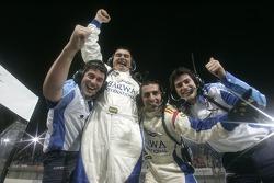 The Barwa International Campos Grand Prix team celebrate Sergio Perez's victory