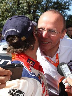 Winner Sébastien Loeb celebrates with Citroen Total World Rally Team boss Olivier Quesnel