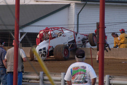 Randy Bateman's car perched on the Turn 1 wall