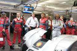 Dr. Wolfgang Ullrich and Audi Sport team members watch as Stéphane Sarrazin try to beat Allan McNish