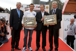 Overall and LMP1 pole winning trophy is presented to Stéphane Sarrazin
