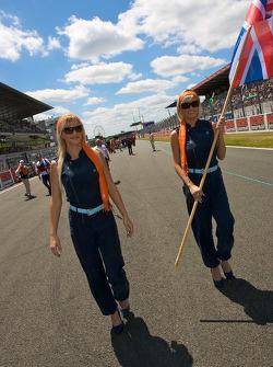 The charming Aston Martin girls walk to starting grid