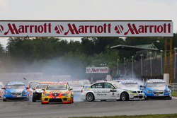 Augusto Farfus, BMW Team Germany crashing in the first corner of Race 1