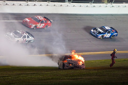 Kertus Davis runs away from his burning race car