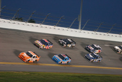Joey Logano, Joe Gibbs Racing Toyota leads a group of cars