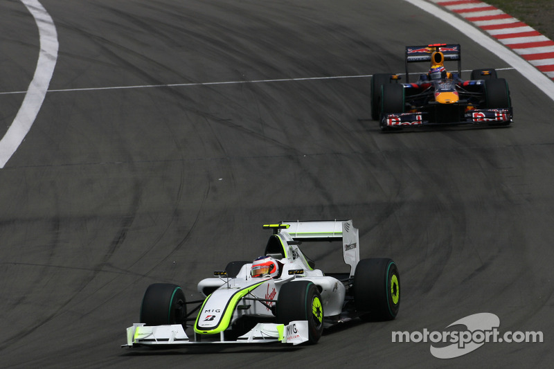 Rubens Barrichello, Brawn GP; Mark Webber, Red Bull Racing