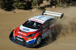 Macus Gronholm negotiates a hairpin on his way up Pikes Peak