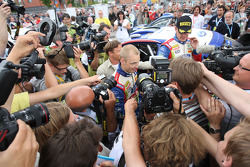 Rally winner Mikko Hirvonen celebrates is surrounded by the media