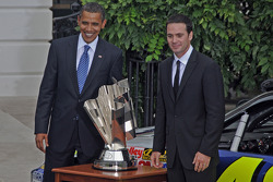 President Barack Obama poses with 2008 Sprint Cup champion Jimmie Johnson and the championship trophy
