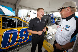 A NASCAR Nationwide Series official and a crew member for Boris Said share a laugh
