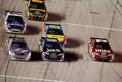 Scott Speed, Red Bull Racing Team Toyota, Casey Mears, Richard Childress Racing Chevrolet and Clint Bowyer, Richard Childress Racing Chevrolet go three-wide