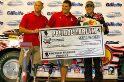 Tony Stewart, driver of the #14 Bass Pro Shops Chevrolet presents a check to the Wounded Warriors after winning