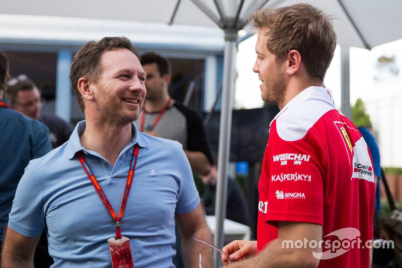 Christian Horner, Red Bull Racing director del equipo y Sebastian Vettel, Ferrari