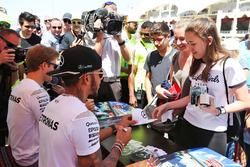 Lewis Hamilton, Mercedes AMG F1 Team and Nico Rosberg, Mercedes AMG F1 Team sign autographs for the fans