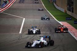 Felipe Massa, Williams FW38, Valtteri Bottas, Williams FW38 and Kimi Raikkonen, Ferrari SF16-H