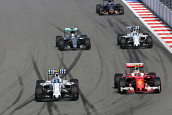 Valtteri Bottas, Williams FW38 and Kimi Raikkonen, Ferrari SF16-H battle for position