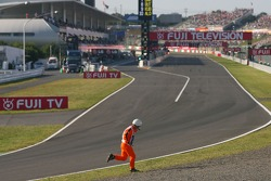 Marshal running on the track