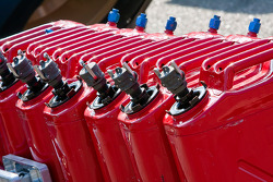 Gas cans wait to be used in the garage area