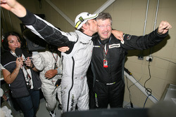 Jenson Button, BrawnGP wins the world championship kisses Ross Brawn