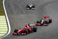 Giancarlo Fisichella, Scuderia Ferrari leads Heikki Kovalainen, McLaren Mercedes