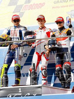 Podium: race winner Casey Stoner, Ducati Marlboro Team, second place Valentino Rossi, Fiat Yamaha Team, third place Dani Pedrosa, Repsol Honda Team