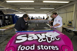 The No. 60 Save-A-Lot Ford goes through inspection