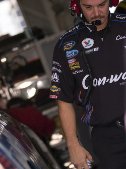 A crewmember for Colin Braun's Con-way Ford go to work