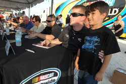 NASCAR Nationwide Series Raybestos Rookie of the Year contender Justin Allgaier meets a young fan