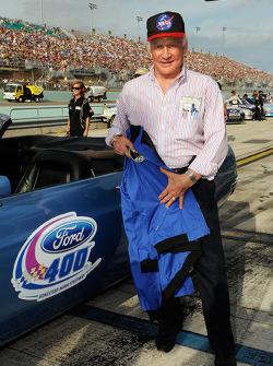Honorary Race Official Buzz Aldrin stands by a 1969 Ford Mustang that he rode in for pace laps prior to the Ford 400