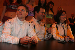 Anthony Davidson and the bbc sports presenters sign autographs for fans