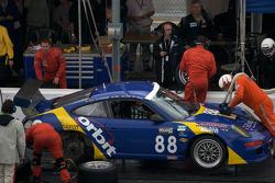 Pit stop for #88 Orbit Racing Porsche GT3: John Baker, Guy Cosmo, Johnny Mowlem, Tom Papadopoulos, Lance Willsey