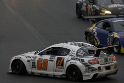 Spin voor #69 SpeedSource Mazda RX-8: Emil Assentato, Anthony Lazzaro, Nick Longhi, Jeff Segal