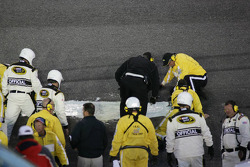 Track maintenance crew at work on the hole in the track between turns 1 and 2 during the second interruption