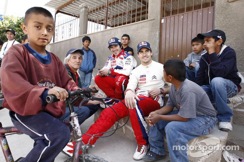 Daniel Sordo en Marc Marti met jonge fans
