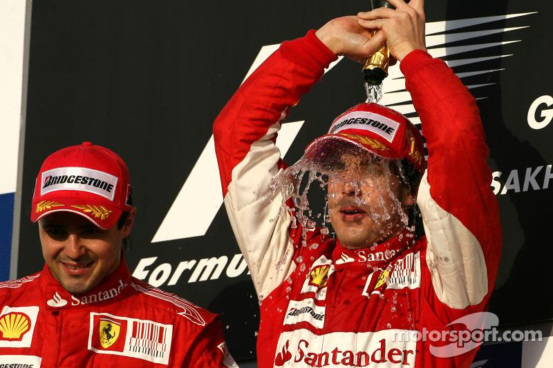Podio: ganador de la carrera Fernando Alonso, Scuderia Ferrari, con segundo lugar Felipe Massa, Scuderia Ferrari