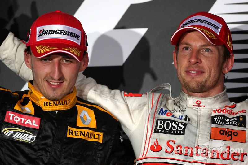 Podium: race winnaar Jenson Button, McLaren Mercedes, 2de Robert Kubica, Renault F1 Team