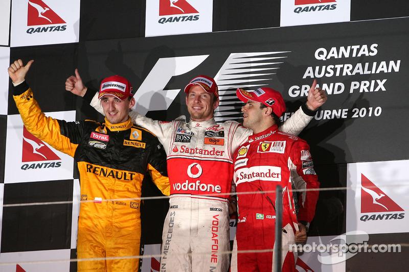 Podium: race winner Jenson Button, McLaren Mercedes, second place Robert Kubica, Renault F1 Team, th