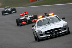 The safety car leads Jenson Button, McLaren Mercedes