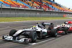Nico Rosberg, Mercedes GP and Lewis Hamilton, McLaren Mercedes make practice starts
