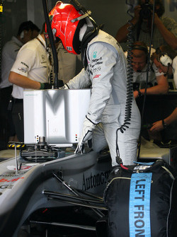 Michael Schumacher, Mercedes GP getting in the car