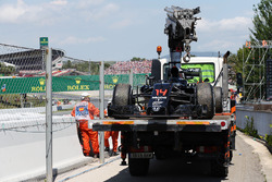 The McLaren MP4-31 of race retiree Fernando Alonso, McLaren is recovered back to the pits on the back of a truck
