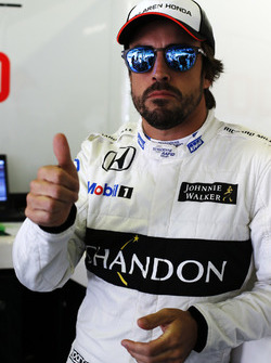 Fernando Alonso, McLaren MP4-31 gives a thumbs up in the garage