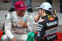 (L to R): Race winner Lewis Hamilton, Mercedes AMG F1 with third placed Sergio Perez, Sahara Force India F1 at the podium
