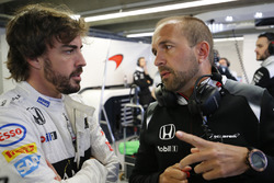 Fernando Alonso, McLaren MP4-31 in the garage with Matt Morris