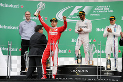 The podium (L to R): Sebastian Vettel, Ferrari, second; Lewis Hamilton, Mercedes AMG F1, race winner; Valtteri Bottas, Williams, third