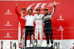 Подіум (зліва направо): Себастьян Феттель, Ferrari, друге місце; Ніко Росберг, Mercedes AMG F1, переможець гонки; Серхіо Перес, Force India F1, третє місце