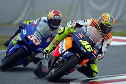 Valentino Rossi, Honda; Akira Ryo, Suzuki